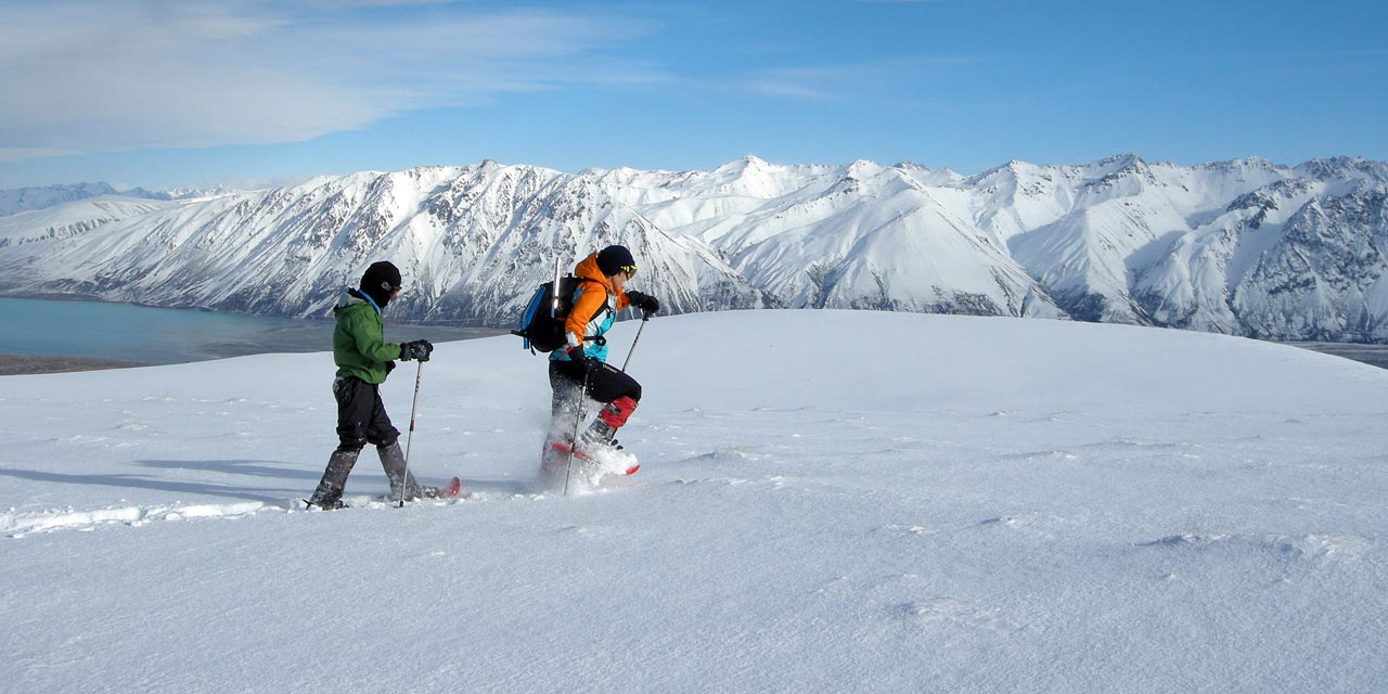 Snowshoers above Lake Tekapo
